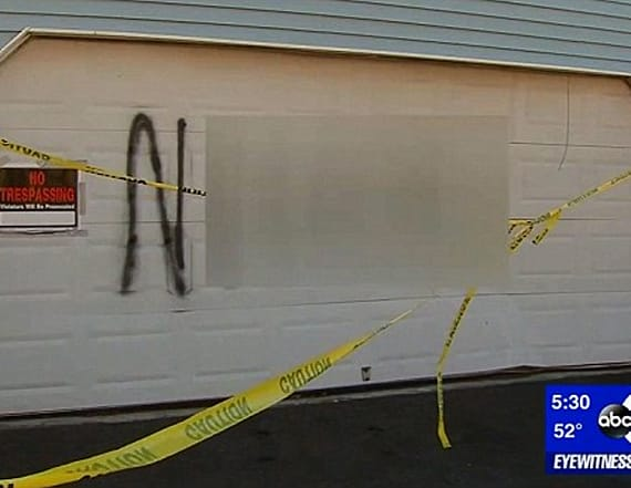 Couple charged for keeping racist graffiti on home
