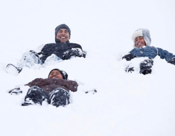 Obama playing in the snow will warm your heart