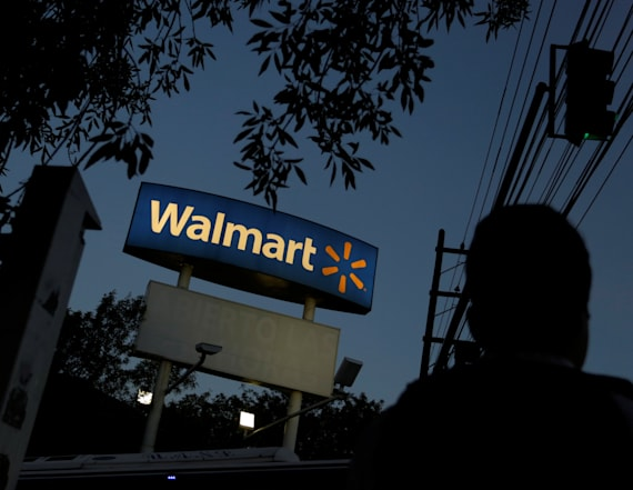 Wall Street hits record highs as Wal-Mart surprises