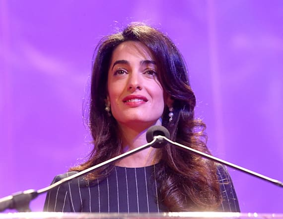 Pregnant Amal Clooney stuns in red