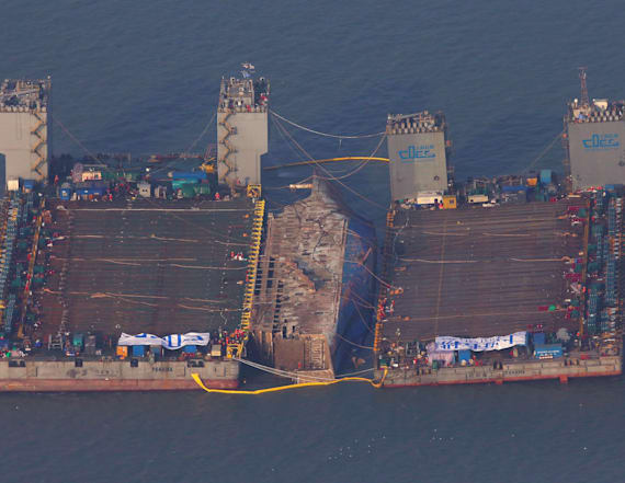 Sunken South Korean ferry slowly emerges