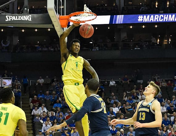 Oregon holds off Michigan as final shot falls short