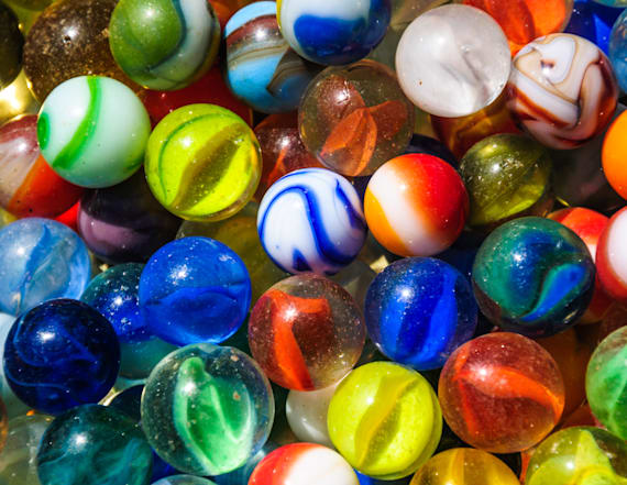 Truck driver loses 38,000 lbs of marbles on highway