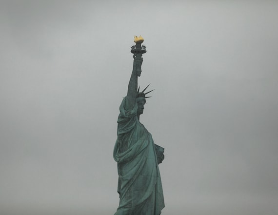 'Refugees welcome' sign placed on Statue of Liberty