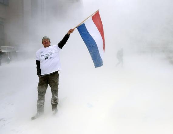 Farmers spray milk powder on EU Council in protest