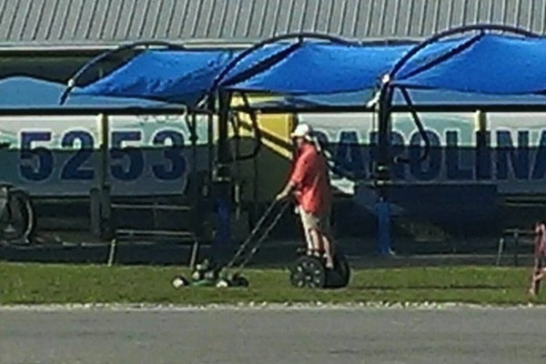people being extremely lazy, funny lazy people, mowing on segway