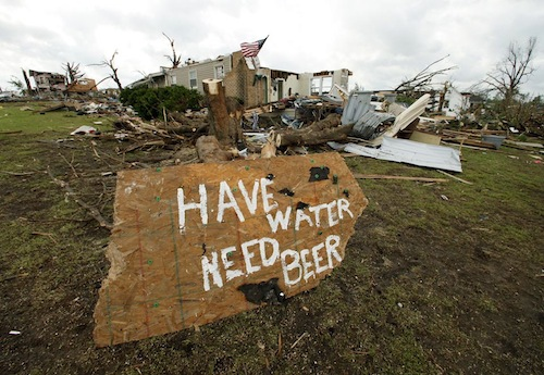 A sign is seen in a devastated neighborhood in Joplin, Mo. Wednesday, May 25, 2011. An EF-5 tornado tore through much of the city Sunday, damaging a hospital and hundreds of homes and businesses and killing at least 123 people. (AP Photo/Charlie Riedel)