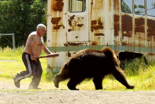 manliest photos on the internet, funny manly images, russian man chases bear with bat