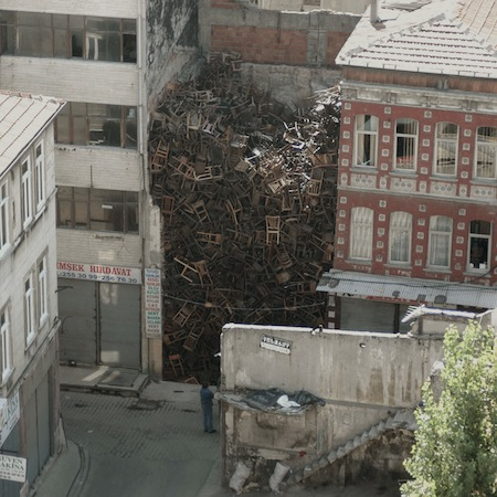 things you don't see every day, 1550 chairs stacked between buildings