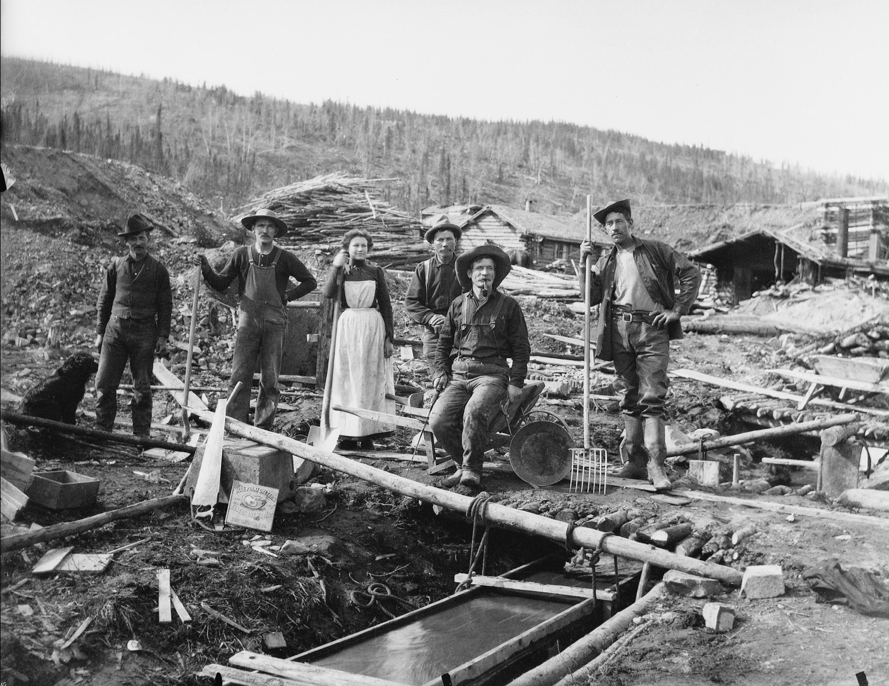 A group of unidentified people sluice for gold during the Klondike gold
