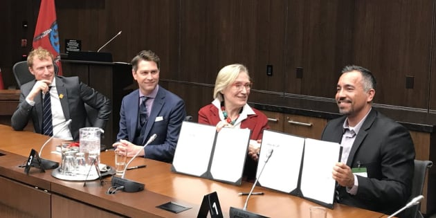 Crown-Indigenous Minister Carolyn Bennett signs a settlement agreement with Frankie Cote, band councillor with Kitigan Zibi Anishinabeg First Nation on March 18, 2019.
