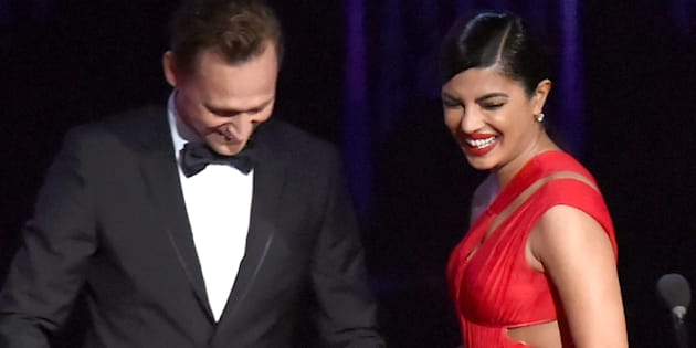 Tom Hiddleston and Priyanka Chopra speak onstage during the 68th Annual Primetime Emmy Awards at Microsoft Theater on September 18, 2016 in Los Angeles, California.  (Photo by Jeff Kravitz/FilmMagic)