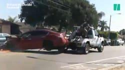 Il tente de détacher sa voiture d'une dépanneuse lancée à toute