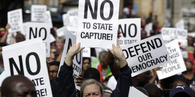 Demonstrators protest against President Jacob Zuma in Pretoria, April 7, 2017.