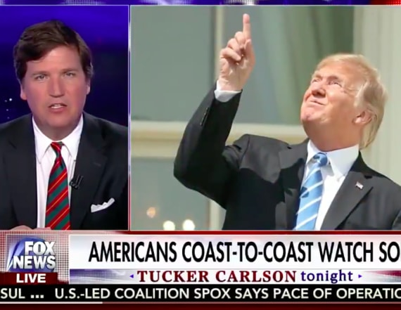 Tucker Carlson reacts to Trump's eclipse stunt