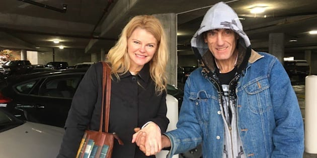 Trinda Gajek, left, and Raymond Ahlstrom pose after the return of her lost ring in Nanaimo, B.C., in this recent handout photo.