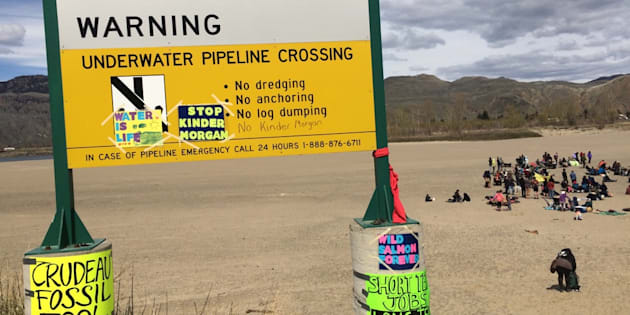 "People rally at a ""Picnics not Pipelines"" event in Kamloops, B.C. on April 22, 2018."