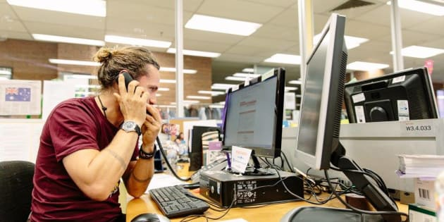 Musician John Butler answers phones during the ASRC's 2016 telethon.