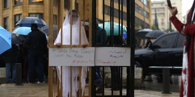 An activist from Abaad, a women's rights group in Lebanon, protests a law that shields rapists from prosecution on the condition that they marry their victim.