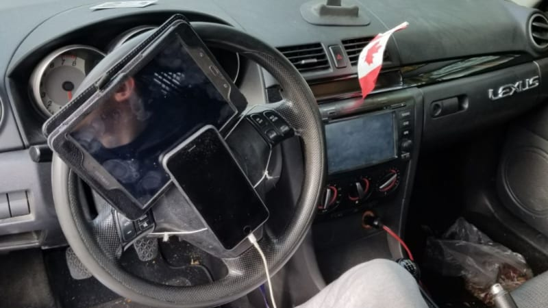 Driver caught with iPhone and tablet tied to steering wheel in Vancouver