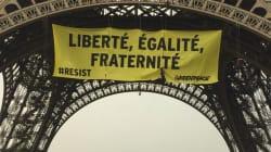 Des militants Greenpeace suspendus à la Tour Eiffel pour déployer une banderole