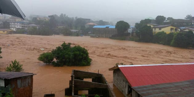 In this image made available by Society 4 Climate Change Communication, Sierra Leone, mud and water flow in Freetown Sierra Leone Monday Aug. 14, 2017. Mudslides after heavy rains and flooding killed scores of people in Sierra Leone's capital on Monday. ( Society 4 Climate Change Communication via AP)