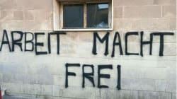 Scritta nazista sul muro di un centro per migranti in