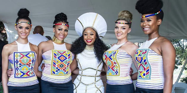 Minnie Dlamini flanked by her bridesmaids.