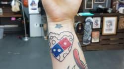 ドミノ・ピザのロゴをタトゥーで入れたら、100年間ピザ無料 ⇒
