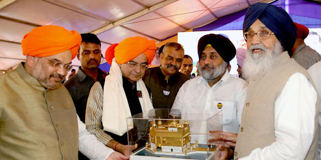 AMRITSAR, INDIA - NOVEMBER 1: (From Left) Bharatiya Janata Party National President Amit Shah, Union Finance Minister Arun Jaitley, Deputy CM of Punjab Sukhbir Singh Badal, being honoured by Punjab CM Parkash Singh Badal during the 50th year of Punjabi Suba celebration rally on November 1, 2016 in Amritsar, India. (Hindustan Times via Getty Images)