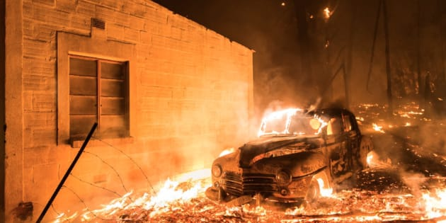 A car and a house burns on Tuesday, 3 January 2017 on the Helderberg Mountains outside Somerset West.
