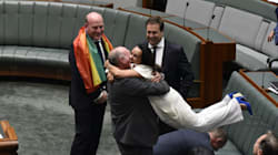 Australian Lawmakers From Opposing Parties Hug Joyously After Same-Sex Marriage