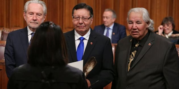 Sen. Daniel Christmas, centre, is pictured with Sen. Peter Harder (left) and Sen. Murray Sinclair (right).