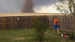 Man Nonchalantly Mows The Lawn While Tornado Swirls In The