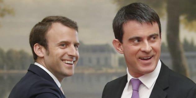 Manuel Valls et Emmanuel Macron, le 7 mai 2014, au Palais de l'Elysée. REUTERS/Christian Hartmann (FRANCE - Tags: POLITICS)