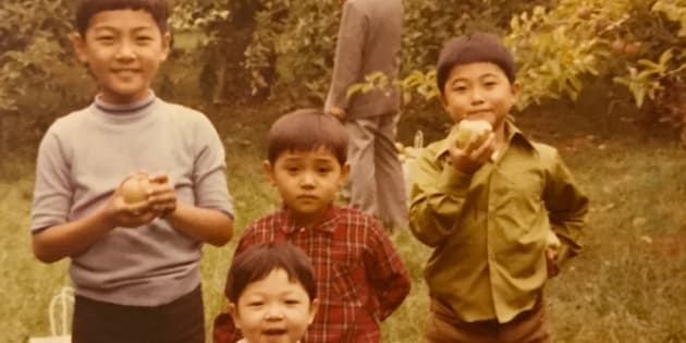 Saewan Koh, on the far right, with his three brothers apple picking in Mississauga, Ont.
