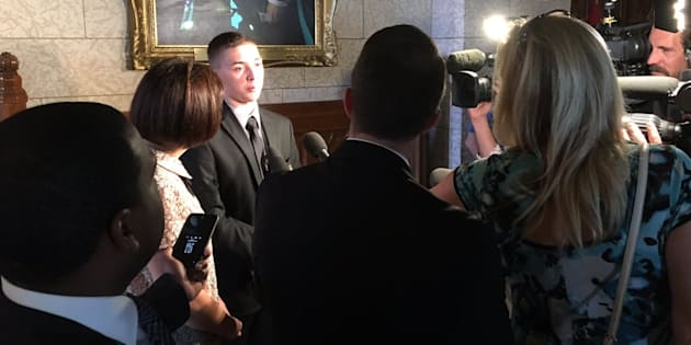 Noah Irvine speaks to reporters in the House of Commons in 2017.