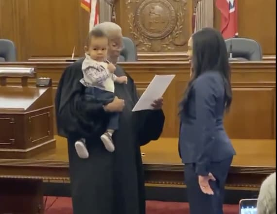 See judge hold lawyer's baby during swearing-in