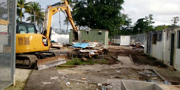 The Manus Island centre, in the early stages of demolition