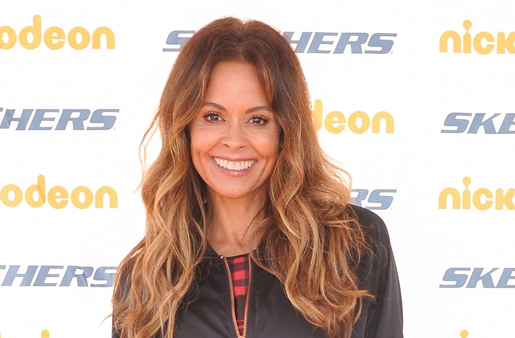 Brooke Burke shows off her physique with nearly-nude