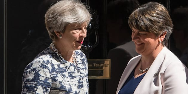 Prime Minister Theresa May greets DUP leader Arlene Foster outside 10 Downing Street in London ahead of talks aimed at finalising a deal to prop up the minority Conservative Government.