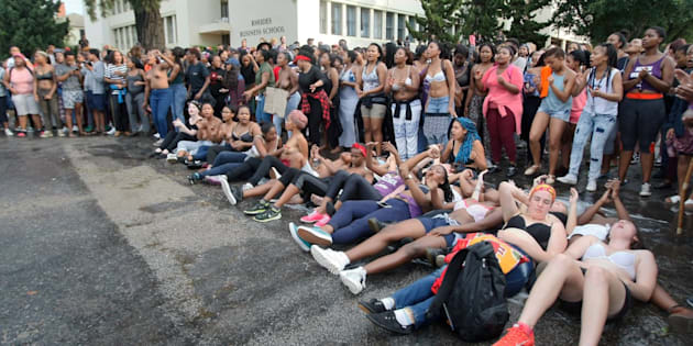 Rhodes University students lie on their backs during protests against sexual violence at the institution on April 19, 2016, in Grahamstown, South Africa. This came after the names of 11 students accused of rape were posted on social media.