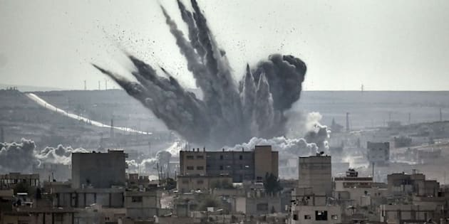 A shell explodes in the Syrian city of Kobane