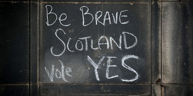 Graffiti written on a wall in support of the Yes voteahead of the 2014 vote.
