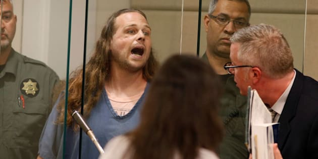 Jeremy Christian yells as he awaits his Tuesday arraignment.