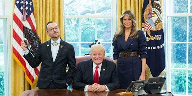 """Nikos Giannopoulos""""celebrates the joy and freedom of gender nonconformity"""" in a photo with Donald and Melania Trump."""