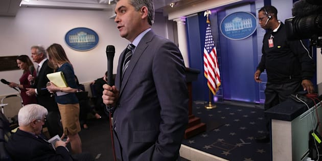 CNN senior White House correspondent Jim Acosta participates in a stand-up shot as he reports after the White House daily briefing on Feb. 7.