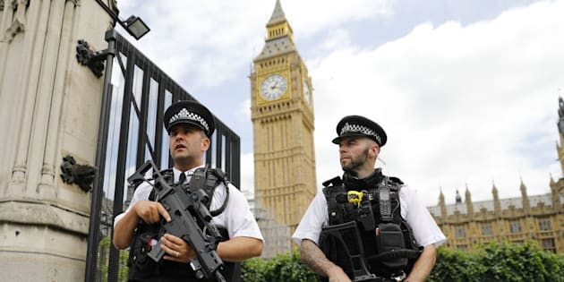 Armed police patrol by the Houses of Parliament on June 16, 2017. London police today arrested a man at the fence surrounding the British parliament on suspicion of carrying a knife, which comes nearly three months after an Islamist terror attack in the same area. / AFP PHOTO / Tolga AKMEN        (Photo credit should read TOLGA AKMEN/AFP/Getty Images)