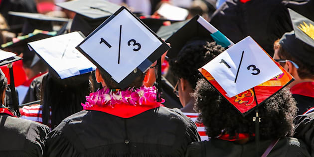Stanford students wear a 1/3 sign on their caps to show solidarity for a Stanford rape victim during graduation ceremonies at Stanford University on June 12, 2016. The 1/3 stands for the statistic that1 in three students will experience sexual assault by the time they graduate.