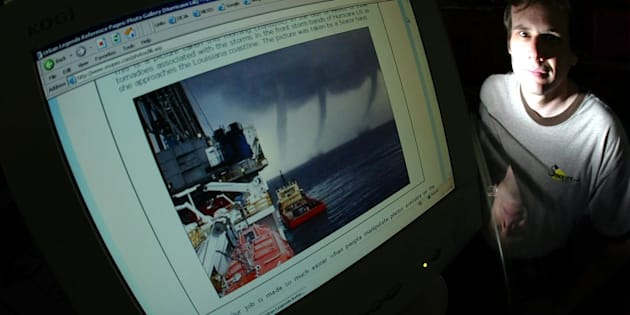 Snopes owner David Mikkelson poses next to a doctored storm photo. He is at the center of a legal battle for control over the popular fact-checking site.